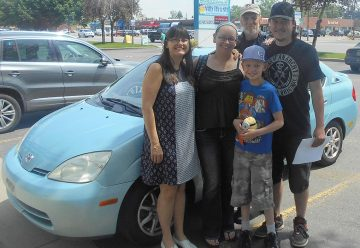 Family with car donated by a supporter